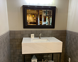 Custom bathroom vanity with beautifully detailed flooring